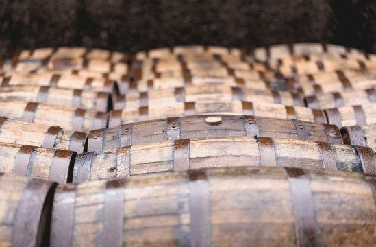 Whisky barrels full of whiskey in Scottish traditional distiller