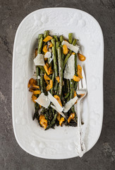 Roasted asparagus and orange pepper in a white serving bowl