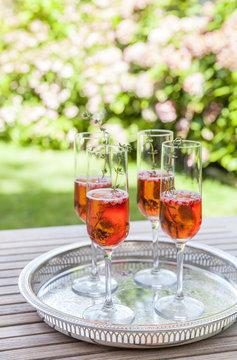 Four glasses of sparkling rose wine