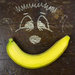Yellow banana and children drawing
