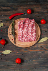 Homemade raw minced meat with herbs closeup