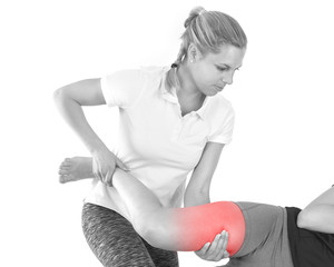 Doctor is stretching woman leg.