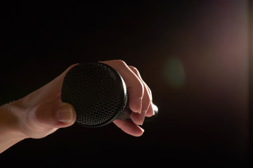 black studio microphone on a dark background