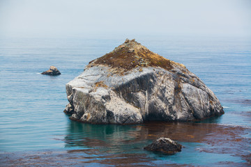 Big rock along Highway One in California - Stock Image