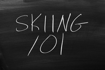 "The words ""Skiing 101"" on a blackboard in chalk"