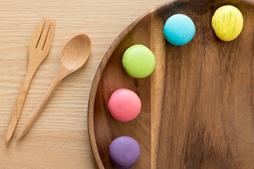 colorful macaron in wooden dish