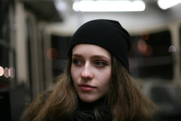 Portrait of casual girl hipster in public transport