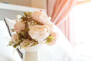 Pink roses on white bed background
