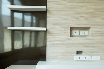 electric outlet in a wall in an modern house interior