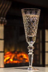 Glass of champagne close-up on the background of fire.