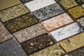 Laying stone floor tiles