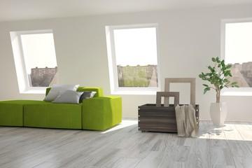 White room with green sofa. Scandinavian interior design