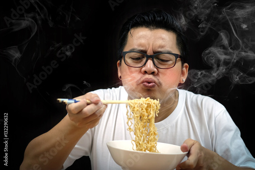 """Asian man eating Instant noodles very hot and spicy on ..."