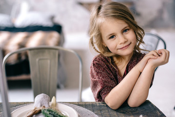 little girl sitting at the table
