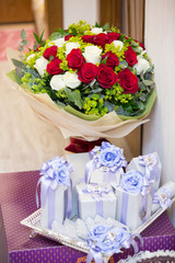 A bouquet of flowers, white and red rose with chocolate gift box, vertical