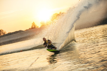 Man wakeboarding on a lake Wall mural