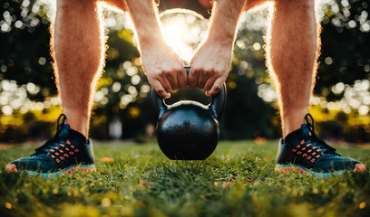 Fitness man working out with kettlebell
