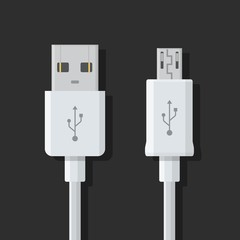 Micro USB cables on dark background. Connectors and sockets for PC and mobile devices. Computer peripherals connector or smartphone recharge supply