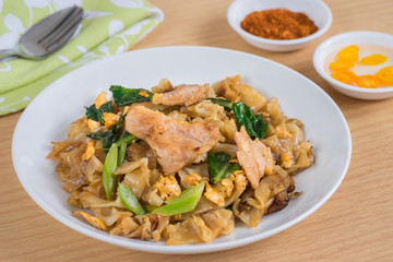 Stir fried rice noodle with pork on plate