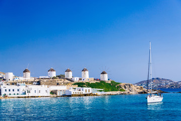 Romantic famous windmills of Mykonos on a bright summer day, Mykonos, Cyclades, Greece