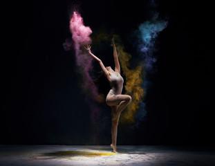 Gymnast in ecru bodysuit with colored dust around
