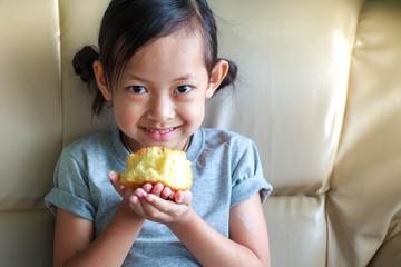 Cute child eating healthy bread at home.Selective focus