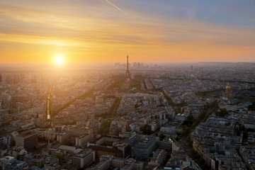 Aerial view of Paris skyline with Eiffel Tower at sunset in Pari