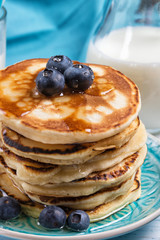 Stack of pancakes with fresh blueberry and honey, healthy breakfast concept, closeup