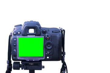 Digital single-lens reflex camera with green screen display stand on tripod isolated on white background