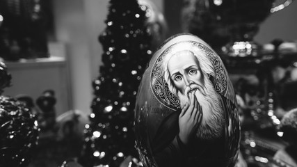 Black and white photo Christmas egg with the Holy Father