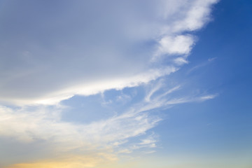Blue sky with closeup white fluffy clouds background and pattern