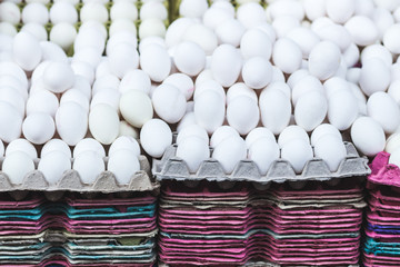 Many white eggs at market, background..