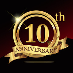10 years golden anniversary logo celebration with ring and ribbon.