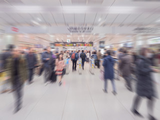 Fast motion blur, people go to train station in rush hour at Jap