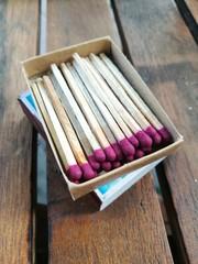 Close up of match stick and match box