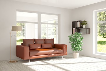 White interior design with sofa and green landscape in window
