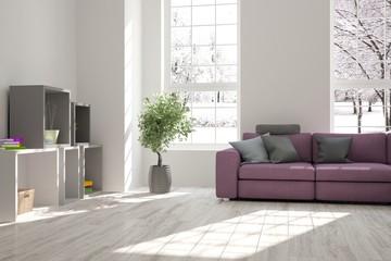 Modern interior design with sofa and winter landscape in window
