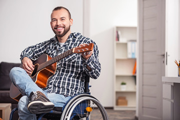 Disabled musician tuning his instrument