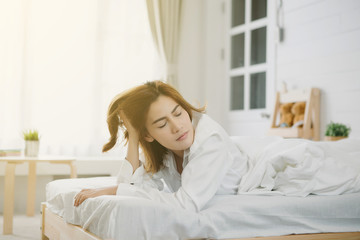 Young beautiful Asia woman hates waking up early in the morning.