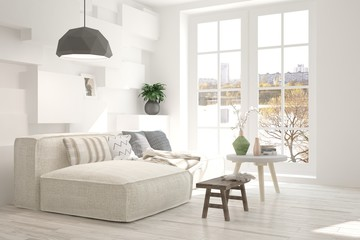 Modern interior design with sofa and urban landscape in window