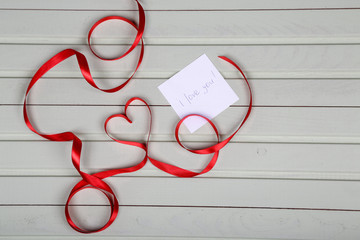 Valentine's day. Heart from red ribbon.