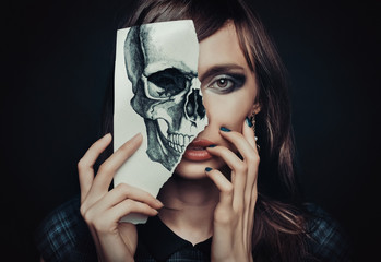 beautiful woman with a painted skull