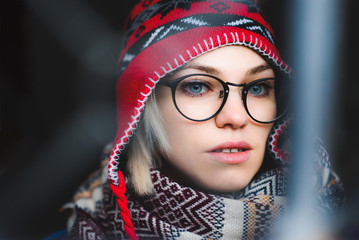 portrait of a girl with glasses and hat