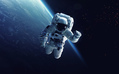 Astronaut at spacewalk. Cosmic art, science fiction wallpaper. Beauty of deep space. Billions of galaxies in the universe. Elements of this image furnished by NASA Wall mural