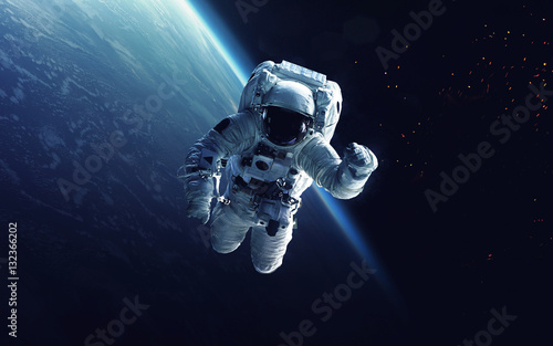 Wall mural Astronaut at spacewalk. Cosmic art, science fiction wallpaper. Beauty of deep space. Billions of galaxies in the universe. Elements of this image furnished by NASA