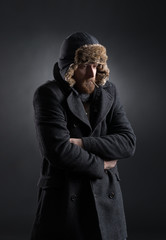 Portrait of a man getting cold in winter clothes