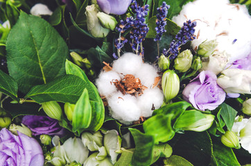 Delicate white ball cotton flower. Details of a bohemian bouquet  flowers. Winter floral composition, green background.