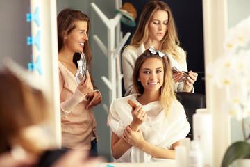 Happy woman in hair studio