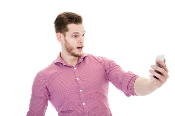 Amazed man looking on smartphone isolated on a white background