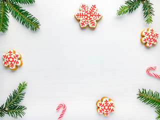 Christmas background with gingerbread cookies  and green fir tre